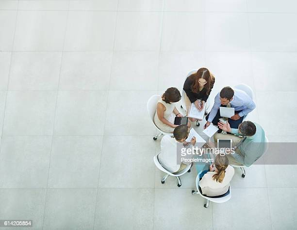 putting their heads together - business strategy stock pictures, royalty-free photos & images