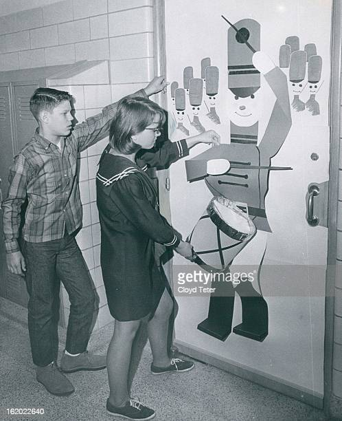 DEC 1966 DEC 21 1966 Putting touches on drummer representing one of Twelve Days of Christmas at West Junior High School are Paul Nisky son of Mrs...