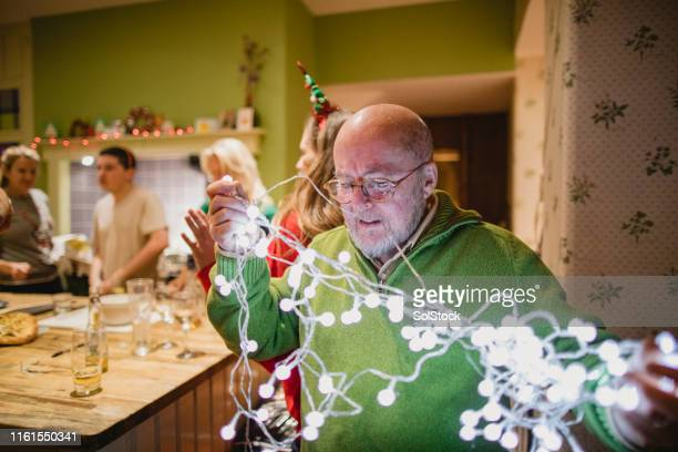 putting up christmas decorations - preparation stock pictures, royalty-free photos & images