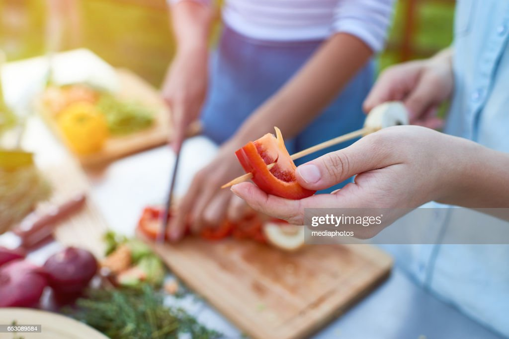 Putting vegetable on stick : Stock Photo