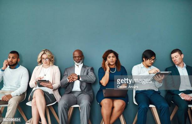 putting waiting time to good use with wireless technology - contact list stock photos and pictures