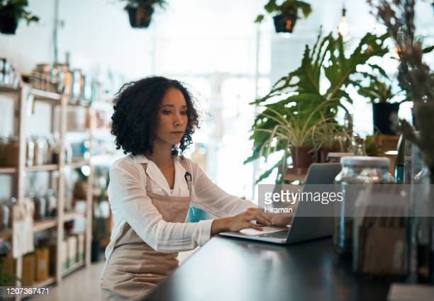 putting your small business online pays off - health food shop stock pictures, royalty-free photos & images