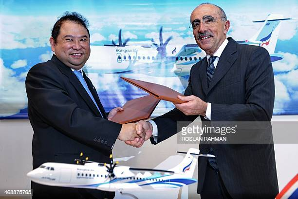 Puttipong Prasarttong-Osoth , President of Bangkok Airways and ATR's Chief Executive Officer Filippo Bagnato , exchange a signed agreement at the...