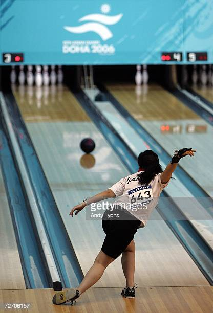 Putty Armein of Indonesia bowls in the Women's Singles Final in the bowling competition during the 2006 Asian Games at Qatar Bowling Centre on...