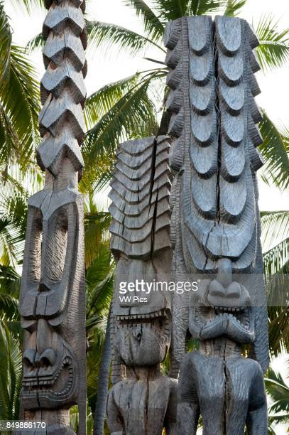 Pu'uhonua O Honaunau National Historic Park Hale O Keawe reconstructed temple with wood carvings South Kona Coast Big Island Ki'i totem images wood...