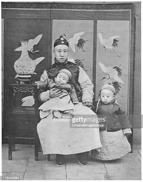PuYi Last emperor of China 19081912 with his father and Regent Prince Ch'un and his little brother PuChieh