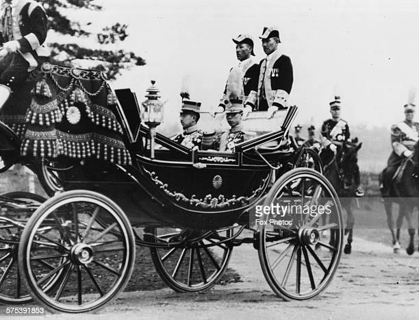 Puyi the Chief Executive of the Japanese puppet state of Manchukuo riding in a carriage with the Emperor May 11th 1935