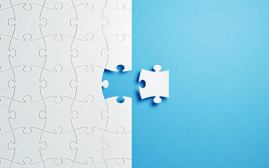 Puzzle Concept - White Jigsaw Puzzle Pieces On Blue Background 927620036