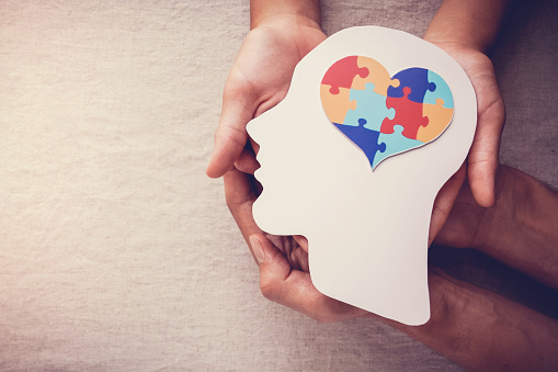puzzle jigsaw heart on brain,  mental health concept, world autism awareness day 1210226489