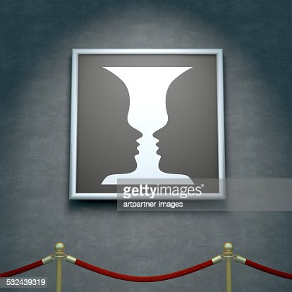 Puzzle Picture Of Two Faces Or A Vase In A Gallery Stock Photo