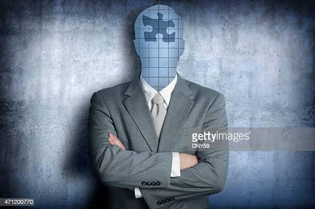 Pièce du Puzzle remplace le visage Homme d'affaires