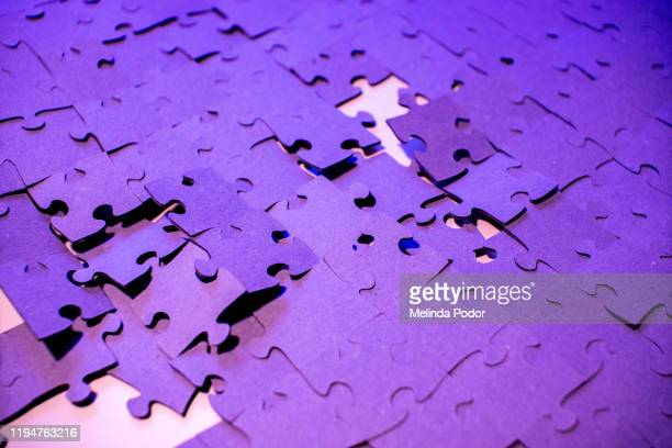 puzzle pieces falling apart - dismantling stock pictures, royalty-free photos & images