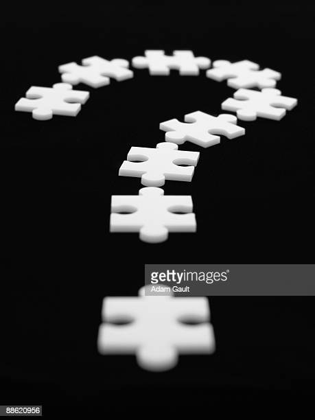 Puzzle pieces in shape of question mark