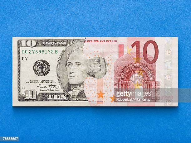 Puzzle pieces of ten dollar bill and ten euro banknote