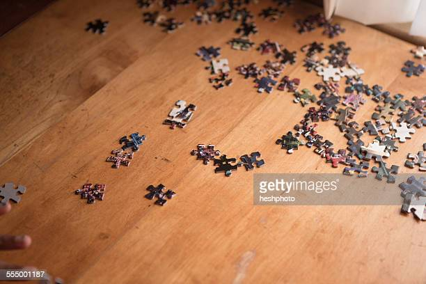 puzzle pieces on a table - heshphoto stock pictures, royalty-free photos & images