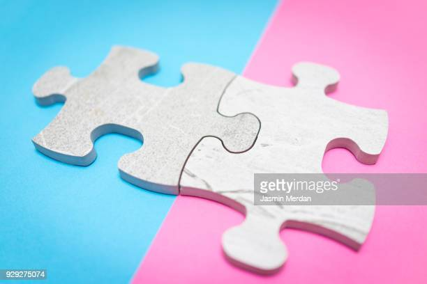 Puzzle pieces on pastel background