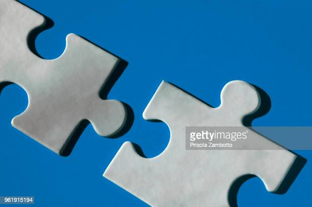 puzzle pieces - things that go together stock photos and pictures