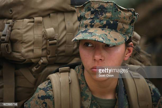 Pvt Jennifer Luna of San Antonio Texas rests following a 10 kilometer training march carrying a 55 pound pack during Marine Combat Training on...