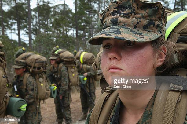 Pvt Melisa Baker of Apple Valley California participates in a 10 kilometer training hike carrying a 55 pound pack during Marine Combat Training on...