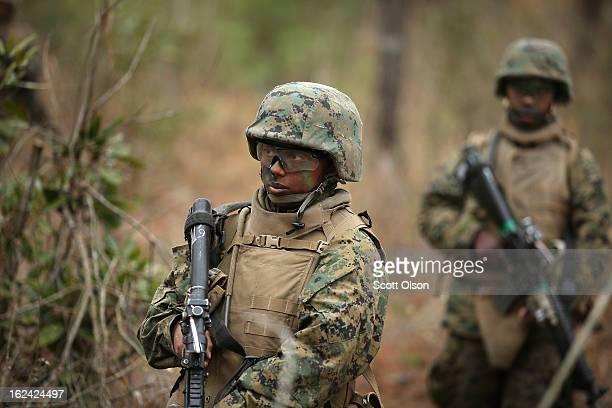 Pvt Tatiana Maldonado of Dallas Texas trains with male and female Marines as she learns patrolling techniques at Marine Combat Training on February...