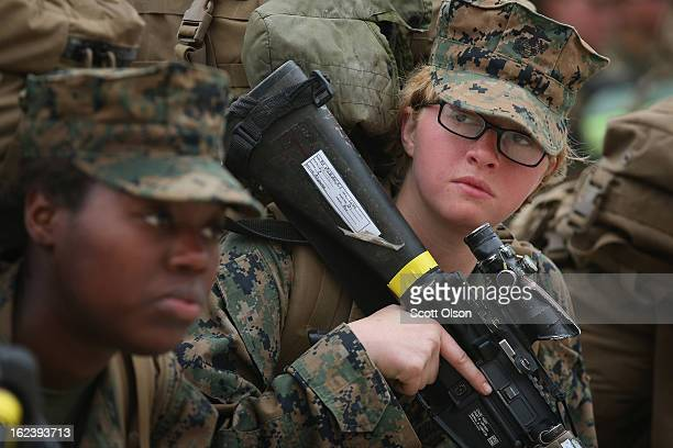 PvtChantelle Mills of Virginia Beach Virginia and Pvt Katie Milburn of Amarillo Texas rest following a 10 kilometer training march carrying a 55...