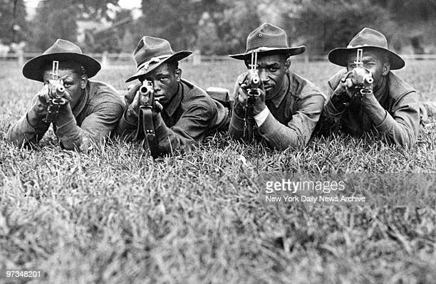 Pvts Earl Martin Tony Hernandez Thomas Shriner and Victor Rossa of the 369th Infantry Regiment train at Camp Smith in Peekskill NY The 369th was one...