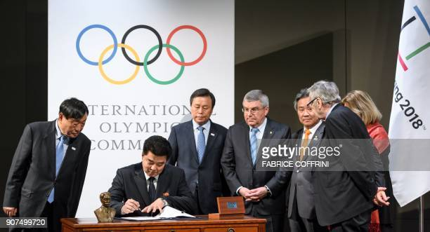 PyeongChang 2018 Olympics president Lee Heebeom looks on as North Korea's Sports Minister and Olympic Committee president Kim Il Guk signs and South...