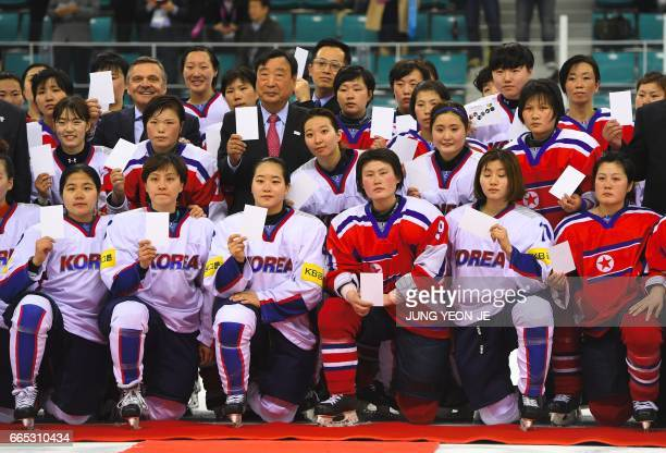 PyeongChang 2018 Organising Committee President Lee HeeBeom poses with players from South Korea and North Korea after the IIHF women's world ice...