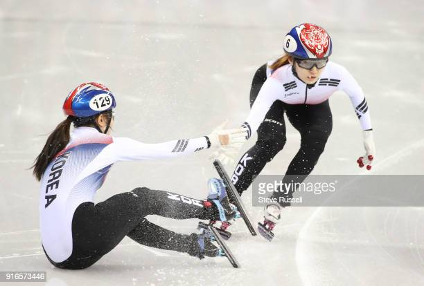 GANGNEUNG Pyeongchang FEBRUARY 10 As Yubin Lee #129 of Korea falls coming out of a corner in the 3000 metre relay race a quick thinking Minjeong Choi...