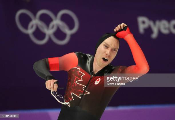 Pyeongchang- FEBRUARY 15 - Ted-Jan Bloemen of Canada looks at the clock as he wins the gold medal in Olympic record time in the men's 10000 metres in...