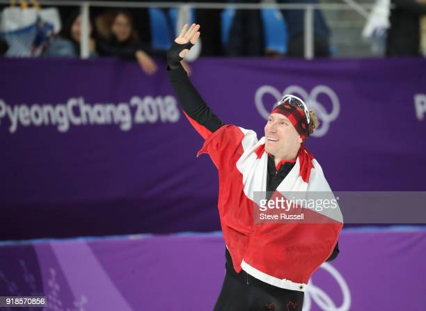 GANGNEUNG Pyeongchang FEBRUARY 15 TedJan Bloemen of Canada takes a victory lap after winning the gold medal in Olympic record time in the men's 10000...