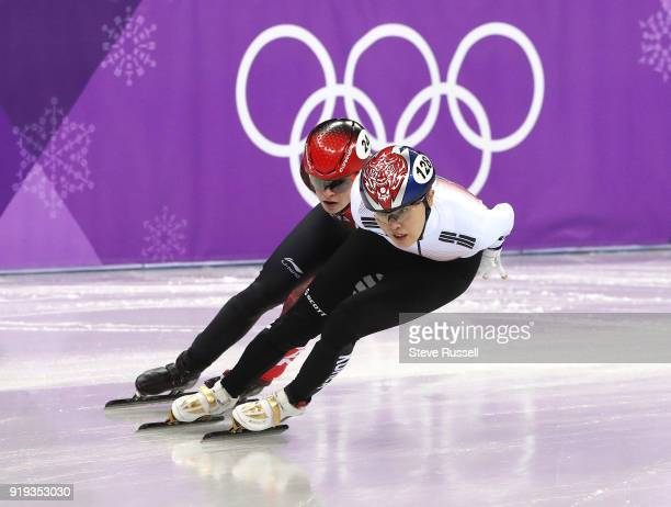 GANGNEUNG Pyeongchang FEBRUARY 17 Kim Boutin of Canada chases Alang Kim of Korea in the short track speed skating program in the PyeongChang 2018...