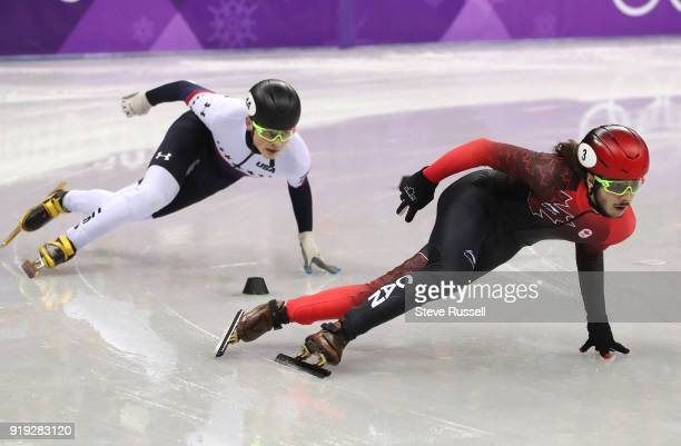 GANGNEUNG Pyeongchang FEBRUARY 17 Samuel Girard of Canada leads on the last lap with JohnHenry Krueger of the United States chasing in the men's 1000...