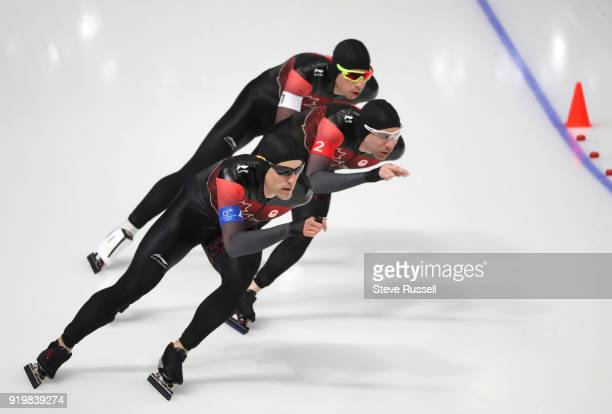 Pyeongchang- FEBRUARY 18 - Team Canada, Jordan Belchos, white armband, Ted-Jan Bloemen, red armband and Denny Morrison, blue armband, compete in the...