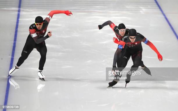 Pyeongchang- FEBRUARY 18 - Team Canada, Jordan Belchos, white armband, Ted-Jan Bloemen, red armband and Denny Morrison, blue armband, start in the...