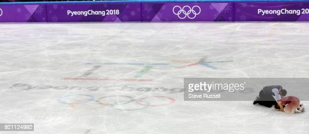 GANGNEUNG Pyeongchang FEBRUARY 19 Ekaterina Bobrova and Dmitri Soloviev of Olympic Athlete from Russia falls to the ice after their program in the...