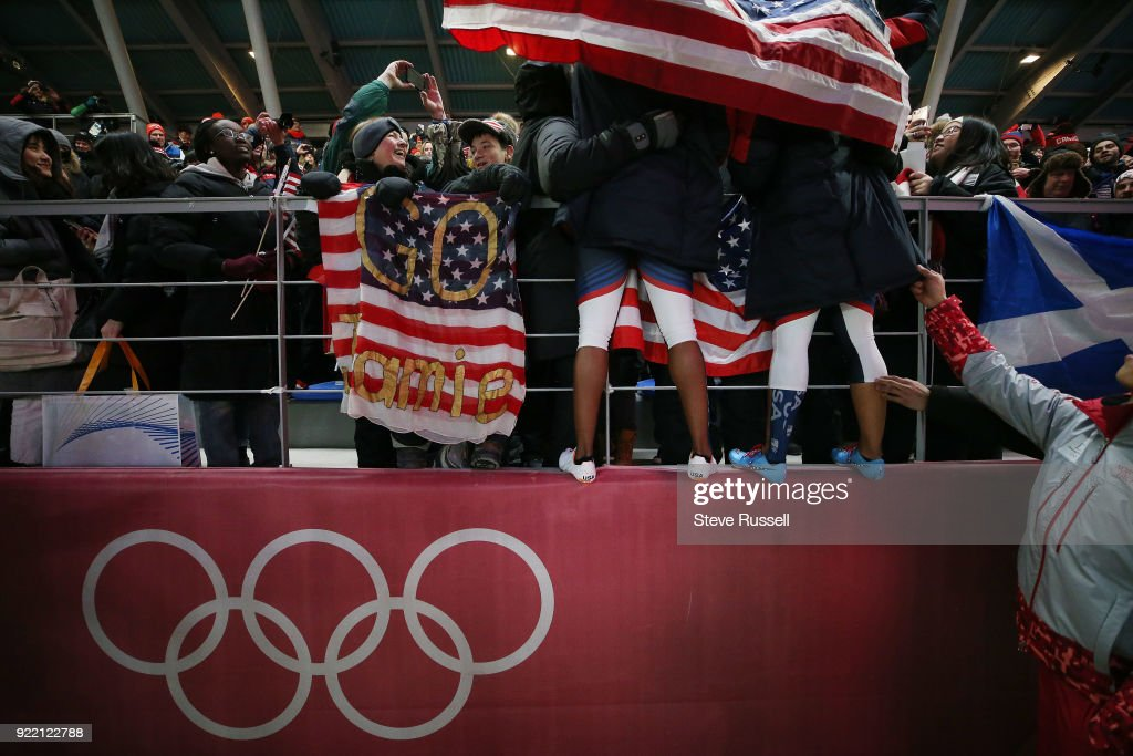 ALPENSIA, Pyeongchang- FEBRUARY 21 - American silver medalists Elana Meyers Taylor and Lauren Gibbs climb the tribunes to greet family and fans in the two-man bobsleigh women at the 2018 Pyeongchang Winter Olympics Olympic Sliding Centre in Alpensia in Pyeongchang in South Korea. February 21, 2018.
