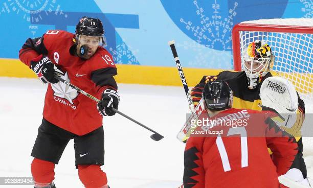 GANGNEUNG Pyeongchang FEBRUARY 23 Canada forward Andrew Ebbett takes a puck to the face as Germany upsets Canada 43 in the men's semifinal in the...