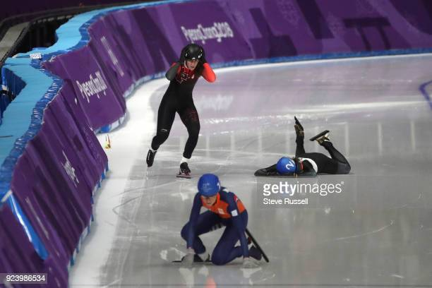 GANGNEUNG Pyeongchang FEBRUARY 24 Ivanie Blondin of Canada loses an edge and takes out Ayano Sato of Japan and Annouk van der Weijden in the Ladies'...