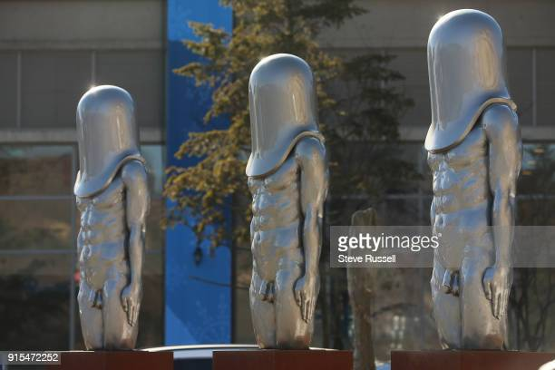 ALPENSIA Pyeongchang FEBRUARY 5 A trio of statues in front of the MAin Press Centre look towards the Alpensia Ski Jump Center at the Main Press...