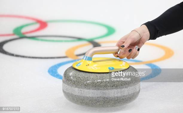 Pyeongchang- FEBRUARY 7 - Olympic Athlete from Russia Anastasia Bryzgalova releases a stone in Mixed Doubles curling at the Gangneung Curling Centre...