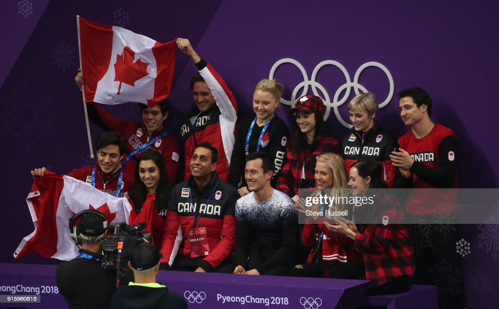 GANGNEUNG, Pyeongchang- FEBRUARY 8 - Patrick Chan of Canada surrounded by teammates listens to his scores in the Men's single skating program in PyeongChang 2018 Winter Olympics Figure Skating team event at the Gangneung Ice Arena at the 2018 Pyeongchang Winter Olympics in Gangneung in Pyeongchang in South Korea. February 8, 2018.