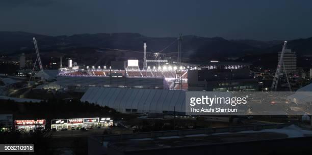 Pyeongchang Olympic Stadium is illuminated one month to go to the PyeongChang Winter Olympics on January 9 2018 in Pyeongchanggun South Korea