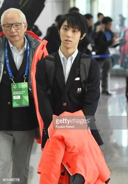 Pyeongchang Olympics men's figure skating gold medalist Yuzuru Hanyu of Japan arrives at Yangyang airport eastern South Korea on his way back to...