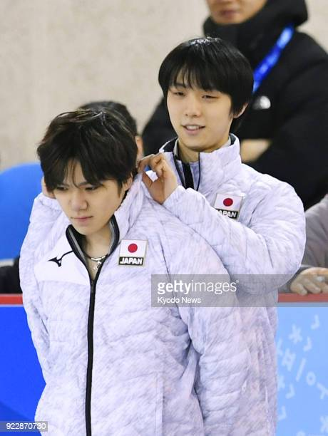 Pyeongchang Winter Olympic gold medalist Yuzuru Hanyu of Japan fixes the collar of his compatriot and silver medalist Shoma Uno during practice in...