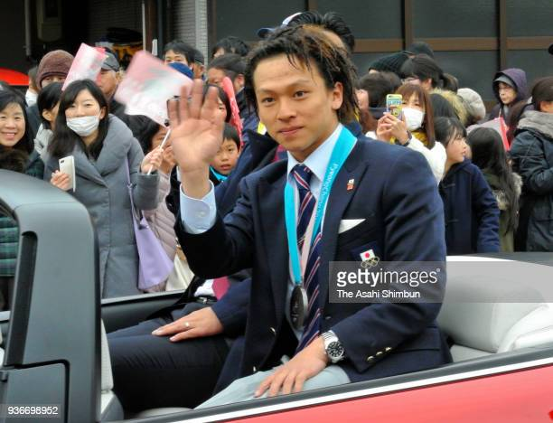 PyeongChang Winter Olympic Snowboard Halfpipe Silver Medalist Ayumu Hirano waves to fans during the parade on March 21 2018 in Murakami Niigata Japan