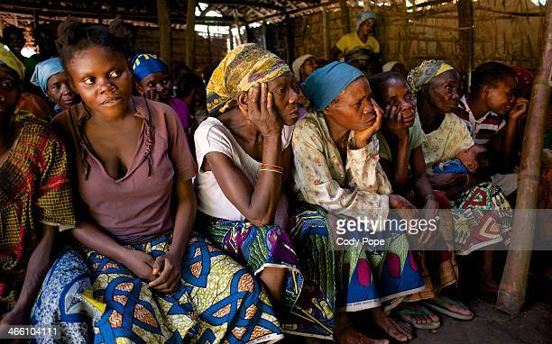 Pygmy women in the village of Bongale 3 learn to read and write. Near the Salonga National Park, in the Democratic Republic of the Congo.