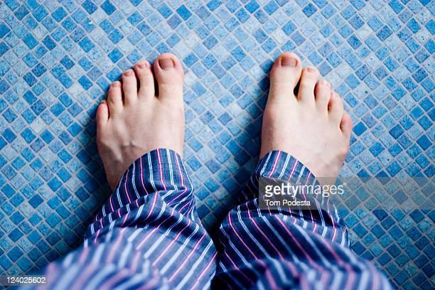 Pyjama feet on blue floor