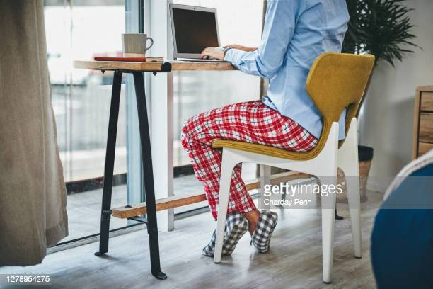 pyjamas all day, the perks of working from home - sock stock pictures, royalty-free photos & images