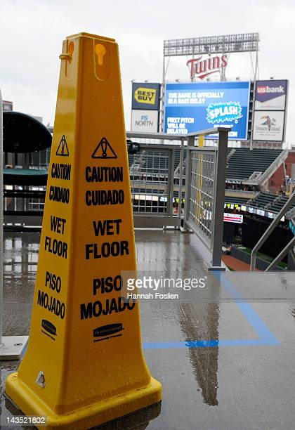 A pylon warns fans as rain as rain delays the start of the game between the Minnesota Twins and the Kansas City Royals on April 28 2012 at Target...